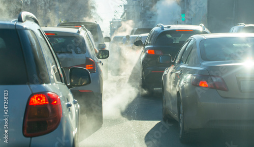 pollution from the exhaust of cars in the city in the winter Canvas