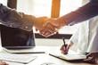 Leinwandbild Motiv Two businessmen handshaking in meeting after final project agreement deal done.