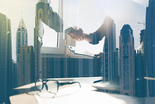 Businessmen Making Handshake In Office