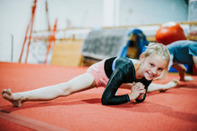 Young Gymnast Stretching Her Body
