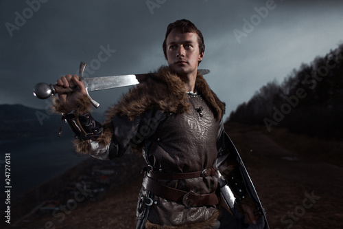 Medieval knight with sword and spear in ancient armour over Winter Landscapes Canvas