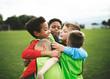 Leinwanddruck Bild - Junior football team hugging each other