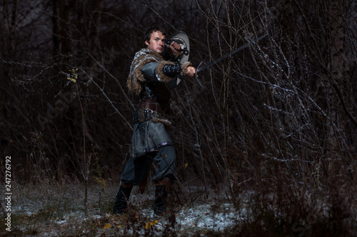 Medieval knight with sword in armor as style Game of Thrones in Winter Forest La Wallpaper Mural