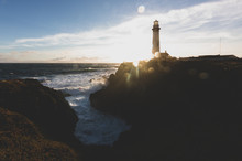 Pigeon Point Lighthouse On Northern California Pacific Ocean Coastline Just Before Sunset With An Artistic Sun Flare, Vintage Look