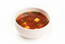 A Photo Of A Bowl Of Miso Soup With Tofu And Scallions On A White Background With Copy Space