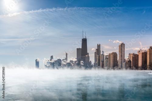 Spoed Foto op Canvas Dubai Fog covers Lake Michigan along Chicago Downtown shoreline. Winter polar vortex