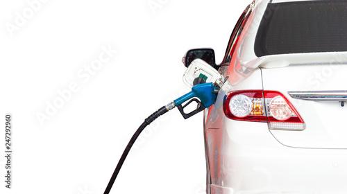 Fotografía  Gasoline dispenser nozzle fuel fill oil into car tank isolated copy space