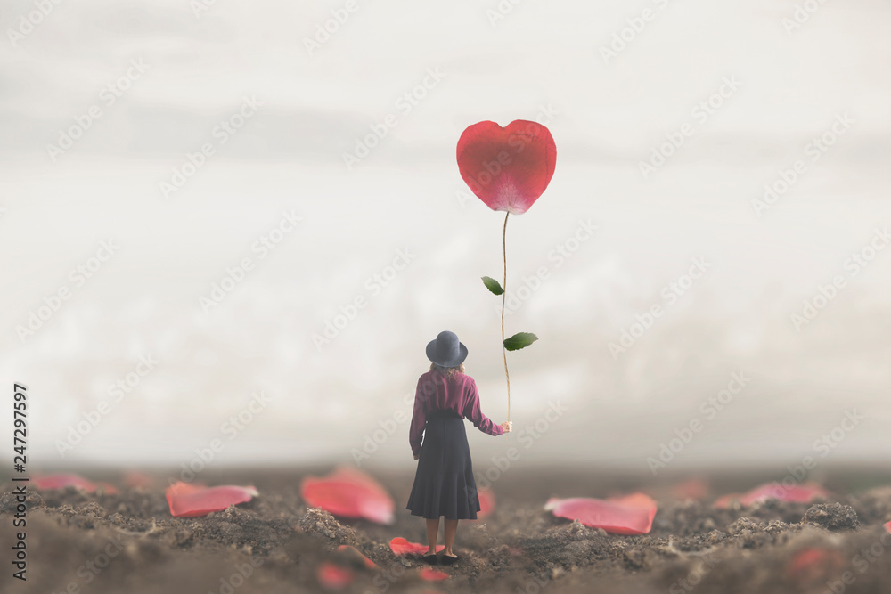 Fototapety, obrazy: lonely romantic woman holds a giant petal made to heart