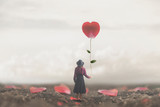 lonely romantic woman holds a giant petal made to heart - 247297597