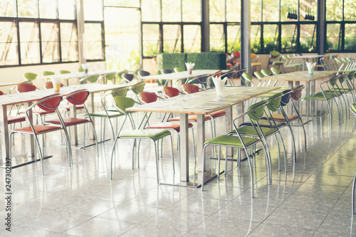 Tables and chairs empty in canteen Fototapet
