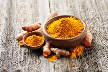 Turmeric Spice In Wooden Board