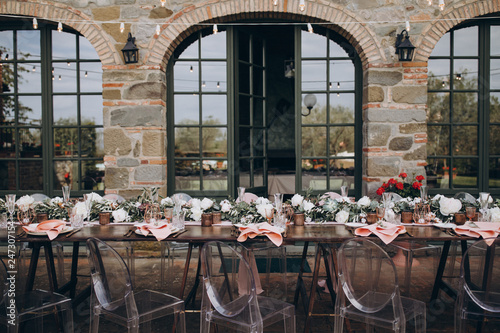 Canvas Print in backyard of villa in Tuscany there is banquet wooden table decorated with cot