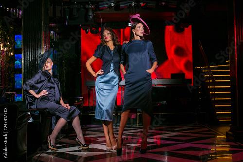 Obraz na plátně  Three beautiful models in a stylish designer clothes