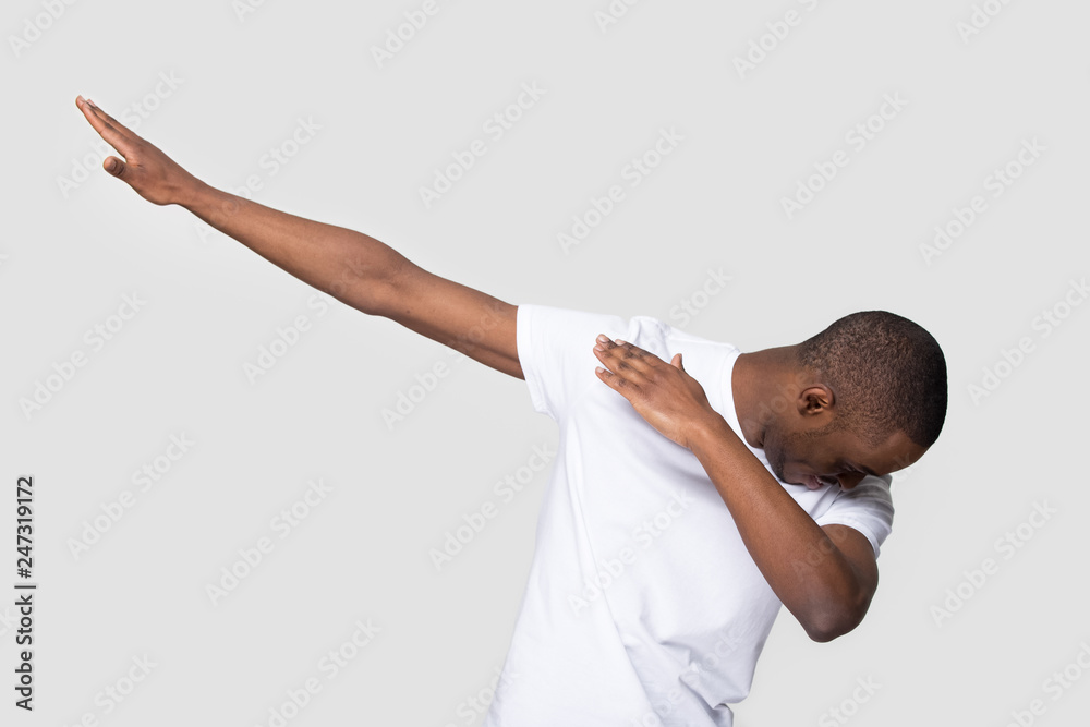 Valokuva  Happy black man making dab arms gesture on blank white grey studio background, f