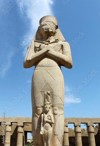 Fotobehang Historisch mon. Carved statue of pharaoh Ramses II situated at Karnak Temple