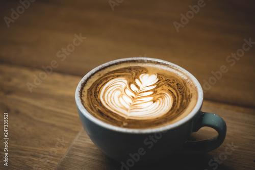 Close up hot cappuccino coffee cup with heart shape latte art on wood table at cafe,Drak tone filter,food and drink Tapéta, Fotótapéta