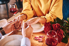 Romantic Moments. Young Man Holding Hands Of His Girlfriend In Restaurant