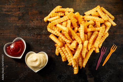 Fototapeta Crinkle cut crispy deep fried Pommes Frites obraz