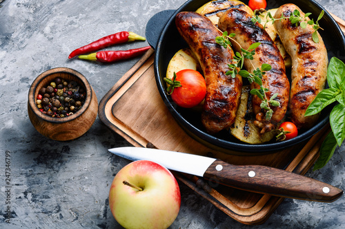 Grill pan with grilled sausages