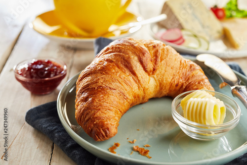 Fotografie, Obraz Croissant served on plate with butter