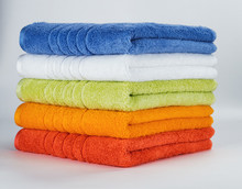 Multicolored Towels On A White...