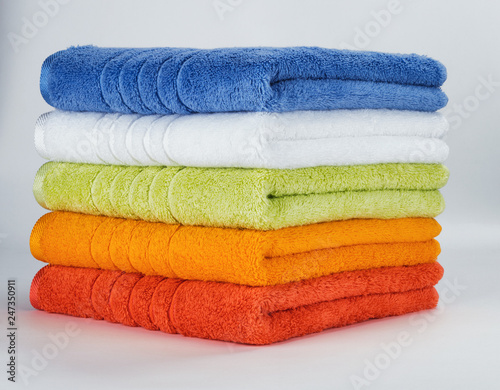 Vászonkép Multicolored towels on a white background