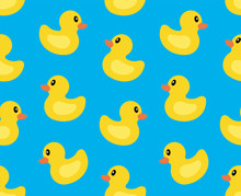 Seamless Pattern With Yellow Duck. Isolated On Blue Background