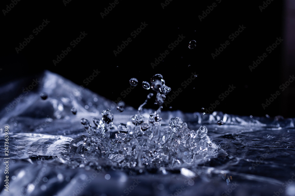 Fototapety, obrazy: Water drops splashing on acoustic membrane. A lot of drops in air. High frequency of sound waves. Water cloud small drops. Frozen time shot.