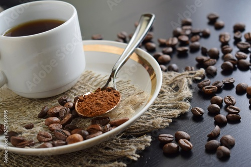 Photo Stands Coffee beans Fragrant coffee in a white Cup on a burlap.