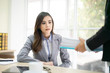 Female employee show pack of documents to busy male manager or boss give extra work to executor. White collar portrait, contract