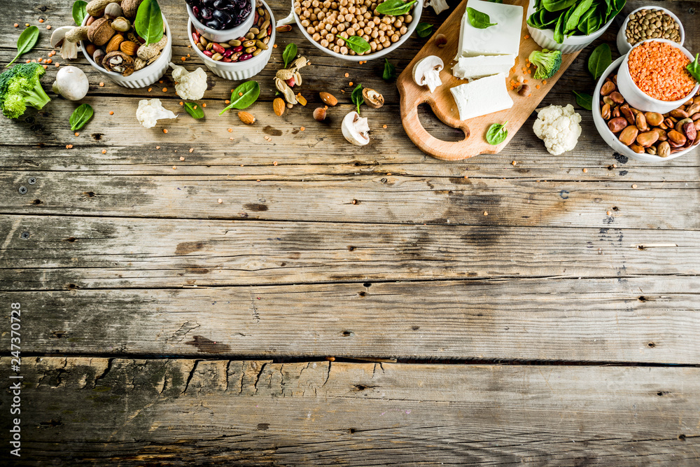 Fototapety, obrazy: Healthy plant vegan food, veggie protein sources: Tofu, vegan milk, beans, lentils, nuts, soy milk, spinach and seeds. Old wooden background copy space banner