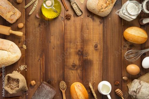 Foto op Plexiglas Bakkerij bread and bakery ingredients on wood