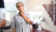 Beautiful Senior Woman Doubtin...
