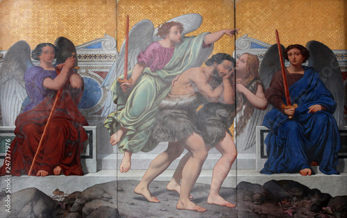 Photo Adam and Eve, the expulsion from paradise , painting on the facade, Saint Vincen