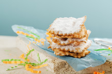 Italian Frappe Or Chiacchiere  - Typical Carnival Fritters Dusted With Powdered Sugar On  Marble Table. With Free Text Space.