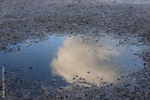 Cloud in puddle reflection gravel Fototapeta