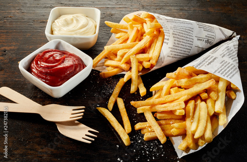 Fototapeta Takeaway servings of deep fried potato chips obraz