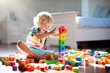 canvas print picture Child playing with colorful toy blocks. Kids play.