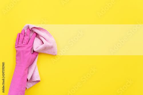 Woman holding cleaning soft pink towel in her hand