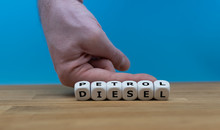 "Petrol Instead Of Diesel. Hand Turns Dice And Changes The Word ""DIESEL"" To ""PETROL"""