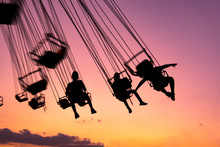 Silhouette Of People Having Fun In Mechanical Game, Flying Chairs In Guatemala, Retalhulehu. Tropical Afternoon.