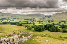 A Valley Of Farm Land And Hills In England. Handmade Stone Walls And Fields.