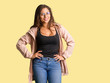 canvas print picture - Full body young curvy woman with hands on hips