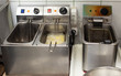 Fryers for roasting potatoes in oil and french fries in the kitchen in the restaurant