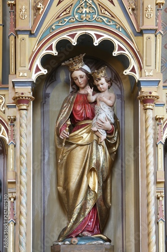 Fototapeta  Virgin Mary with baby Jesus statue on altar of Our Lady in the church of Saint Matthew in Stitar, Croatia