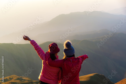 Stampa su Tela Hiker woman feeling victorious facing on the mountain, Thailand