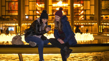 Two Girls Have An Amazing Night In New York While Sitting At A Fountain