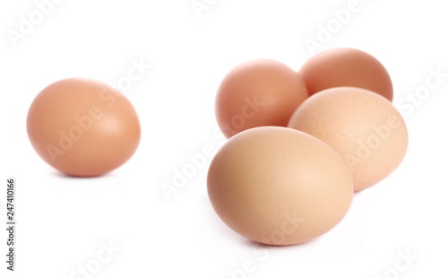 Fresh hen eggs isolated on white background