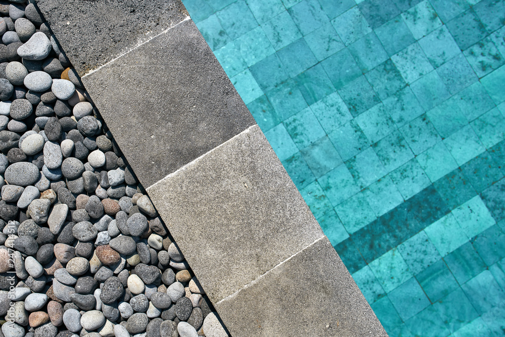 Fototapety, obrazy: Closeup photo of pool edge which decorated with pebbles