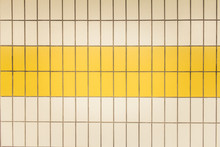 Yellow And White Tiles In A Subway Station In Düsseldorf, Germany